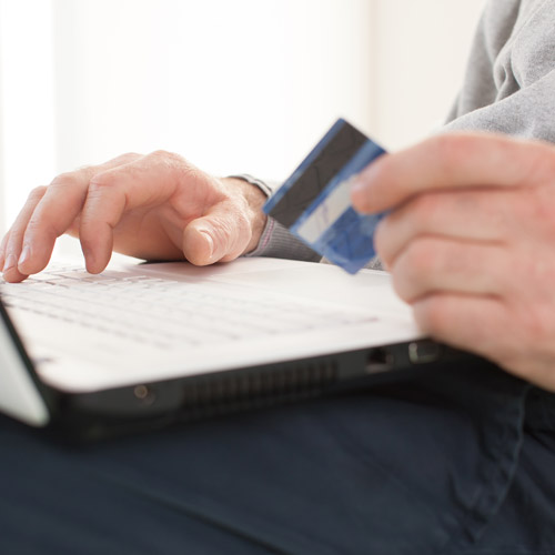 Person paying bills online with credit card