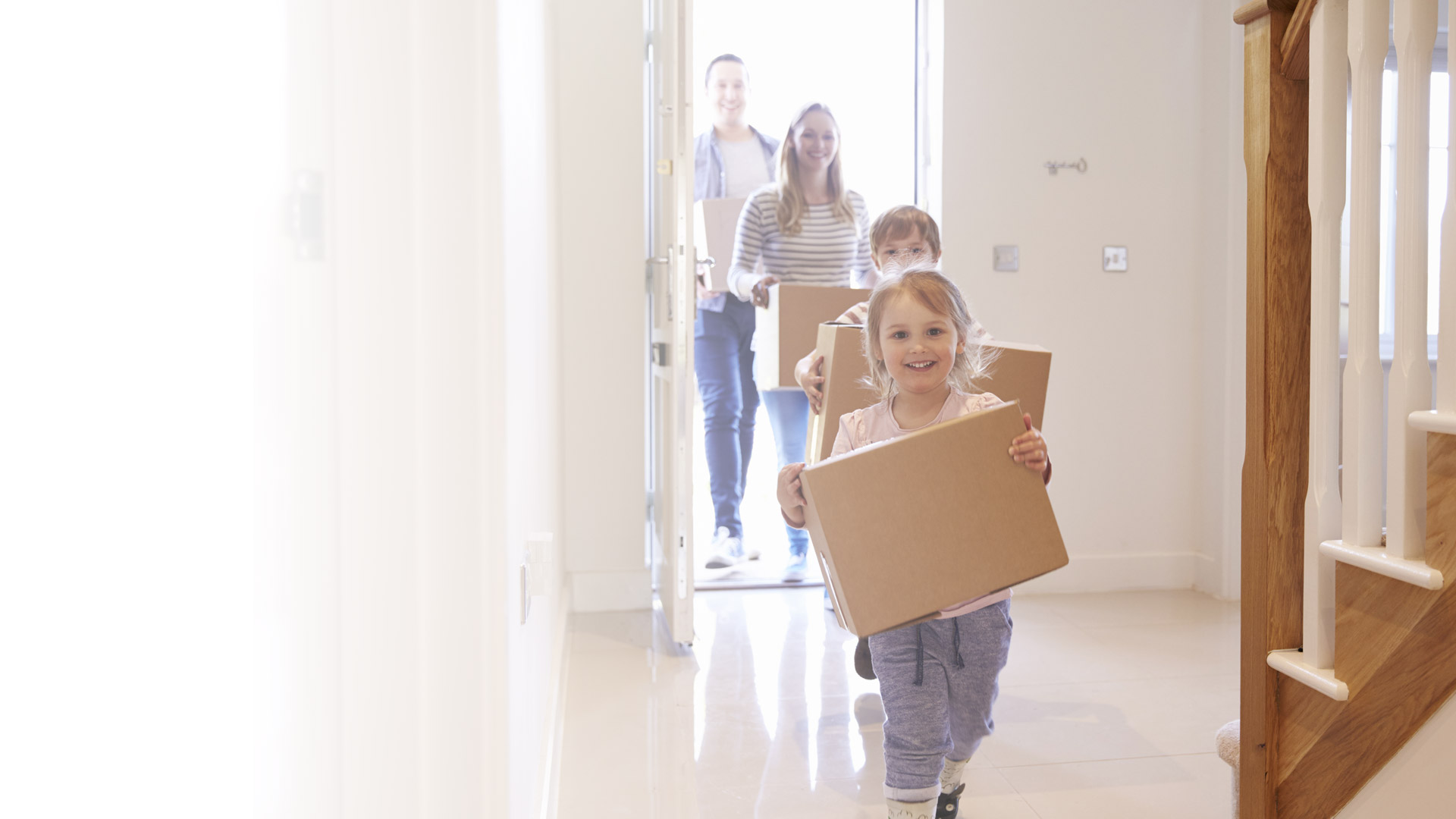 Slider of young family moving into their new home with their new mortgage